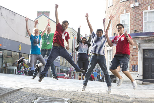 international students jumping for joy